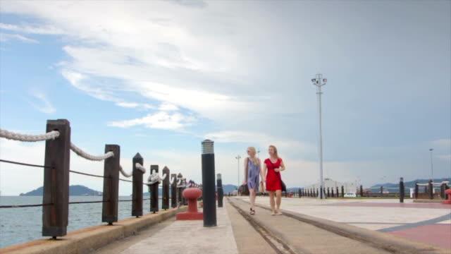 Two Women Walking along a Marina, Sabah video