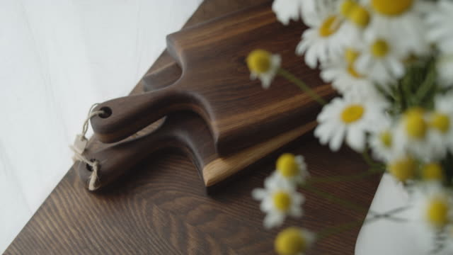 two wooden cutting boards lie on a wooden table - truciolo video stock e b–roll