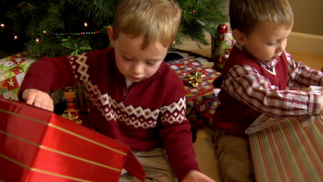 Two young boys opening Christmas gifts video