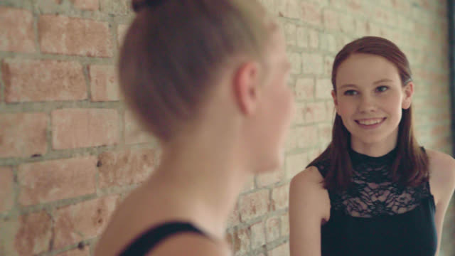Two Young Dancers Talking In a ballet studio leotard stock videos & royalty-free footage