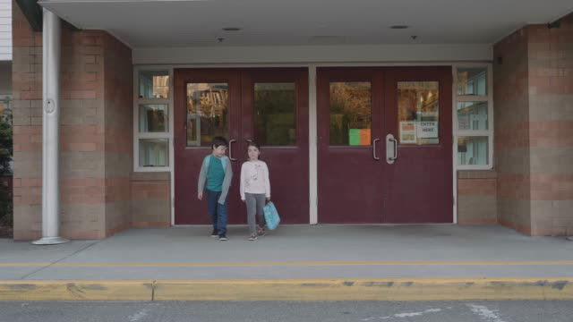 Two Young Kids Leaving School video