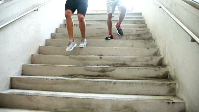 Two young men exercising, running down stairs video