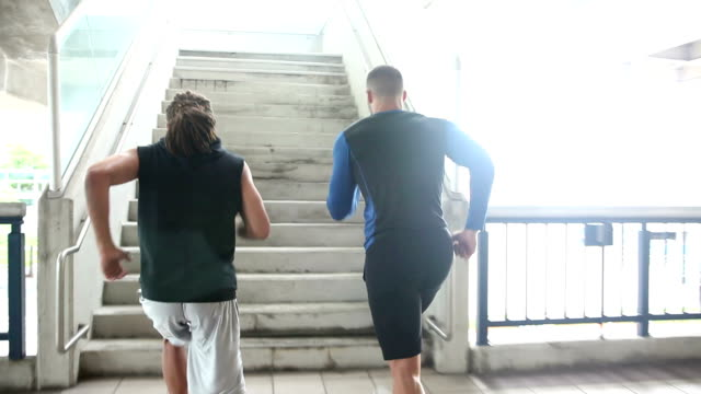 Two young men exercising, running up stairs video