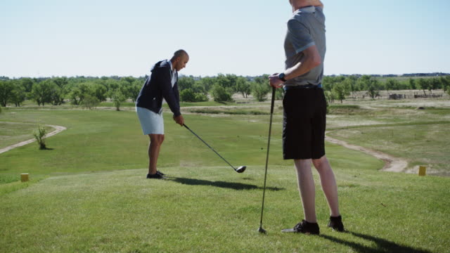 Two Young Men Golf Together video