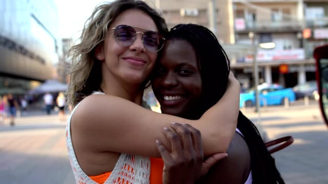 Two young woman have close relationship on the street Two young woman have close relationship on the street bisexuality stock videos & royalty-free footage