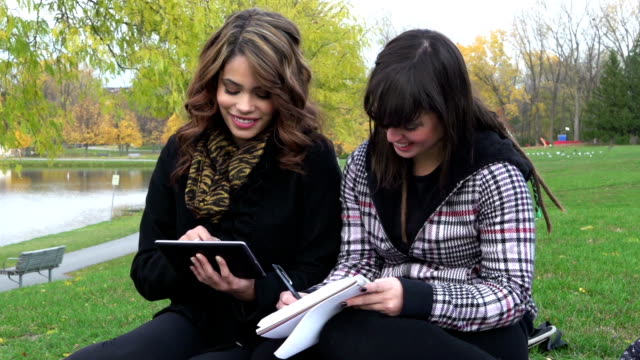 Two young women with digital tablet video