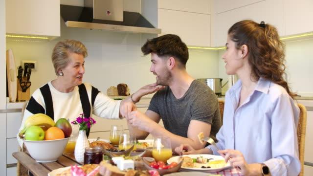 Two-generation family having a breakfast video