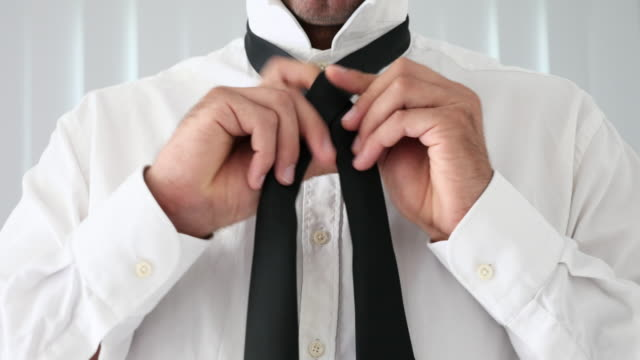 Tying black tie video