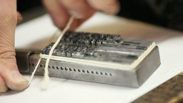 tying letterpress type before printing video