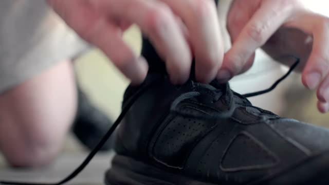 結束靴紐 - 戦い点の映像素材/bロール