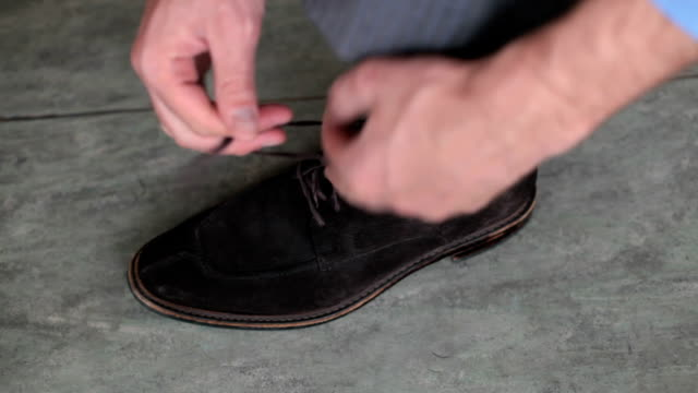 tying the laces of a shoe