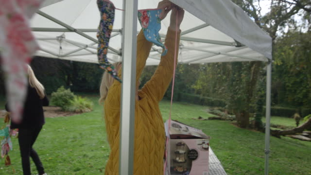 tying up the bunting - gartenparty stock-videos und b-roll-filmmaterial