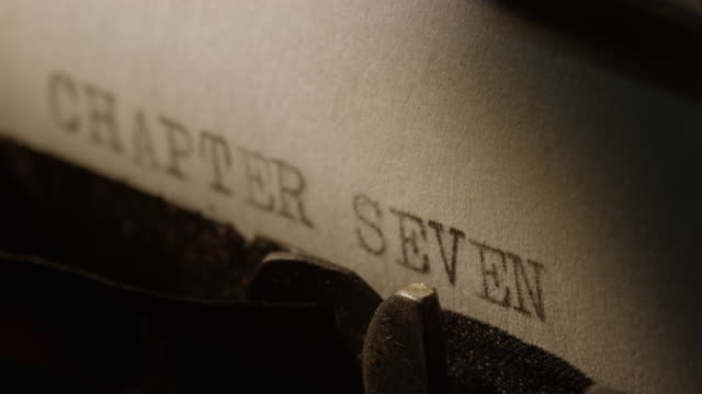 LD Type bars of old typewriter printing out CHAPTER SEVEN video