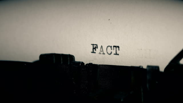 type bars of old typewriter printing out word fact - trasparente video stock e b–roll