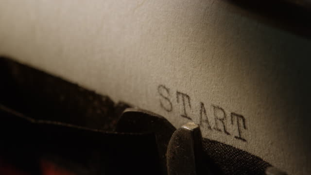 LD Type bars of old typewriter printing out word START Locked down close up shot of the type bars of the old typewriting machine printing out the word Start on a sheet of paper inserted in the machine and moving into the next line. typewriter stock videos & royalty-free footage