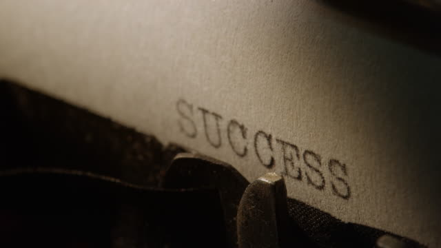 LD Type bars of old typewriter printing the word SUCCESS video