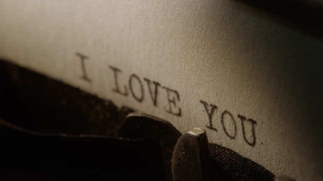 Type bars of old typewriter printing words I LOVE YOU video