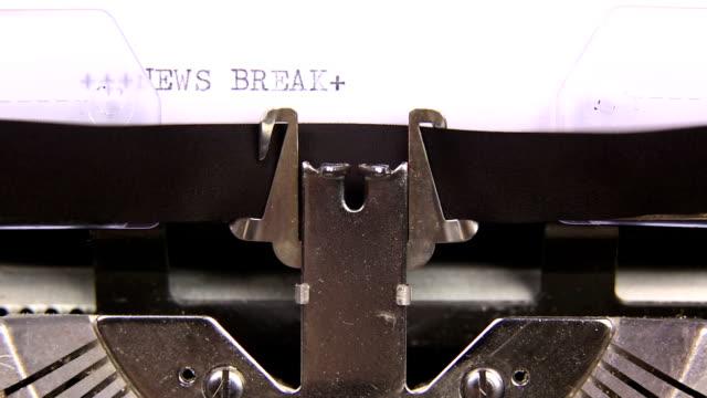 HD NEWS BREAK WEATHER HEADLINES typed  on an old typewriter video