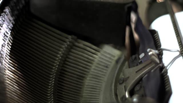 typewriter mallets. typing text. close-up