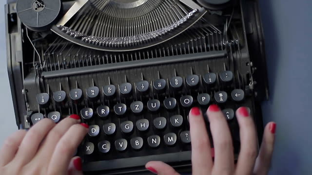 Typewriting - montage Retro Technology. Hands typing on retro typewriter on blue desk. typewriter stock videos & royalty-free footage