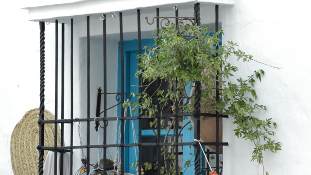 Typical andalusian window of a house with a iron old forge Typical andalusian window of a house with a iron old forge wrought iron stock videos & royalty-free footage