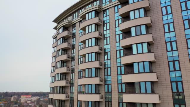 typical apartment building in urban area - appartamento video stock e b–roll