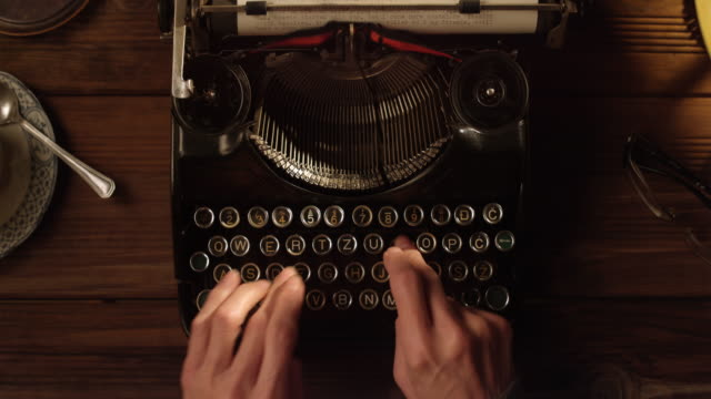LD POV Typing a letter on an old typewriter