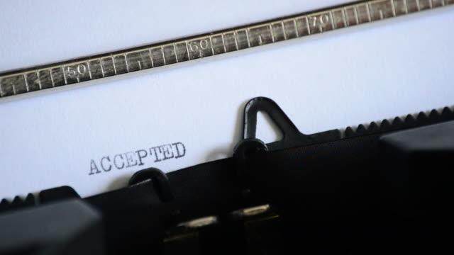 Typing ACCEPTED with an old manual typewriter video