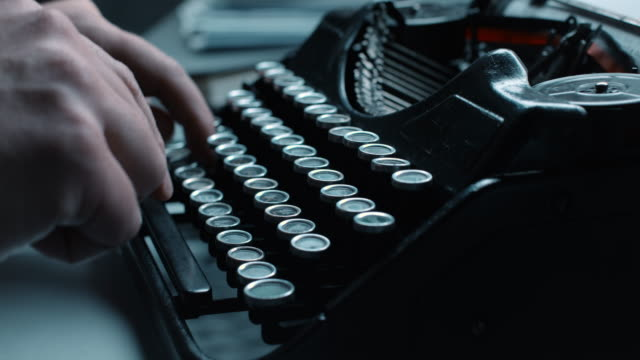 LD Typing fast on an old typewriter Locked down medium shot of a person's fingers typing fast on an old typewriter. typewriter stock videos & royalty-free footage