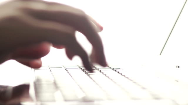 Typing fingers push notebook video