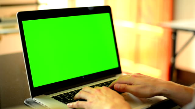 Typing On Notebook Computer With Green Screen At Home video