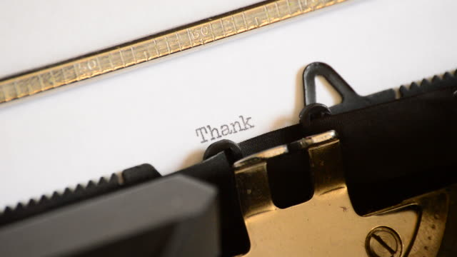 typing thank you with an old manual typewriter - thank you stock videos and b-roll footage