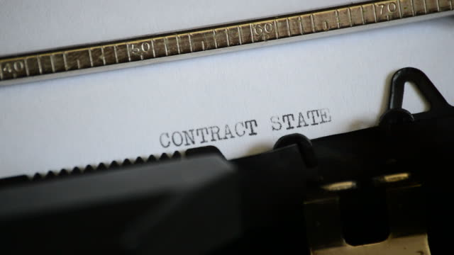 Typing the expression CONTRACT STATEMENT with an old manual typewriter video