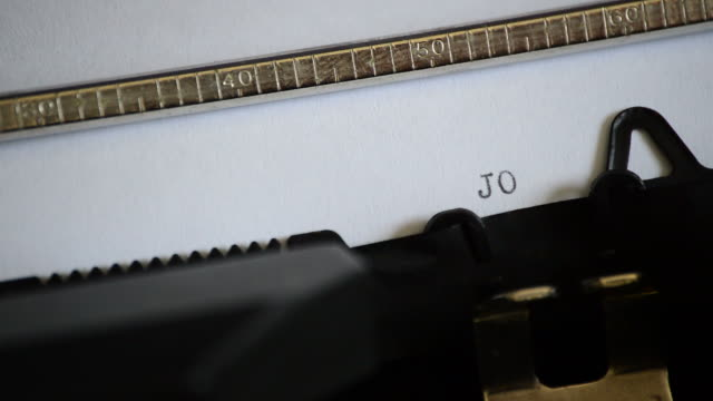 Typing the expression JOIN US with an old manual typewriter video