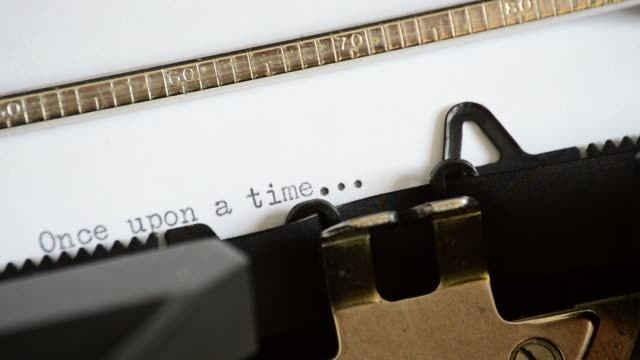 Typing the expression Once upon a time with an old manual typewriter video