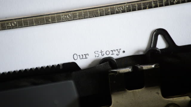 Typing the expression Our Story with an old manual typewriter Typing the expression Our Story with an old manual typewriter typewriter stock videos & royalty-free footage