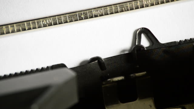 Typing the word INCORRECT with an old manual typewriter video