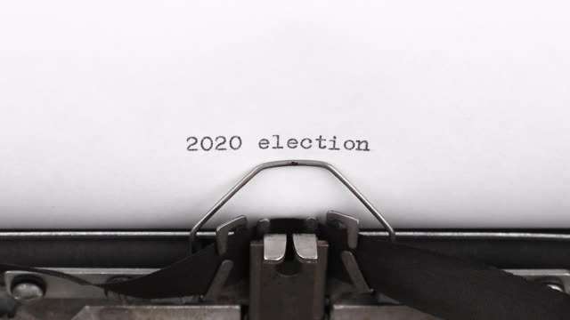 typing words 2020 election on a vintage typewriter close-up typing words 2020 election on a vintage typewriter close-up typewriter stock videos & royalty-free footage