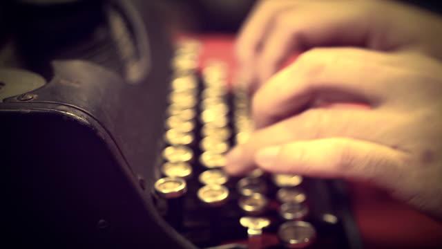 Typist pressing buttons on vintage typewriter machine, retro video archives video