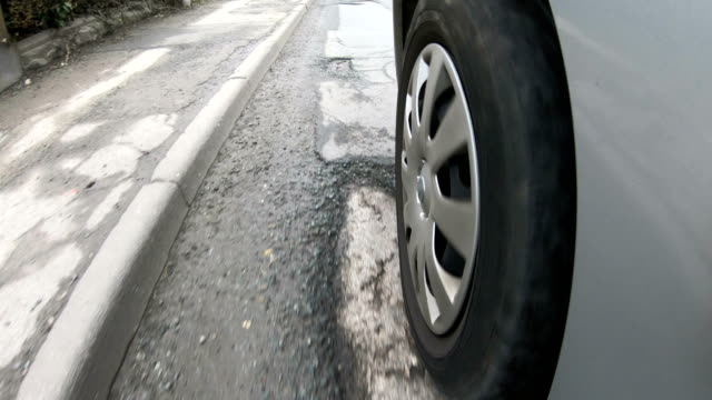 4K: Tyre view of many Potholes on damaged Street / Road video