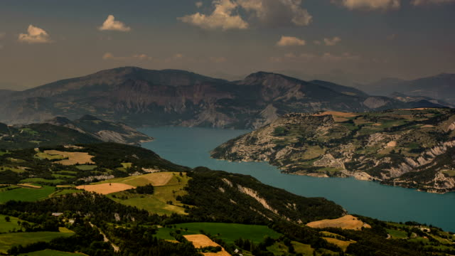 ubaye artificial lake and rolling hills alpes de haute provence - barrage de serre poncon stock videos & royalty-free footage