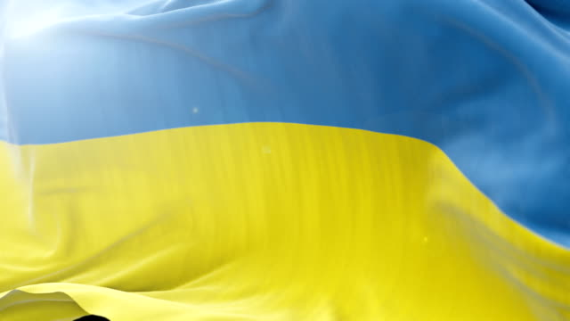 ukraine flag slow waving background. 4k close up flag waving. seamless loop - politica e governo video stock e b–roll