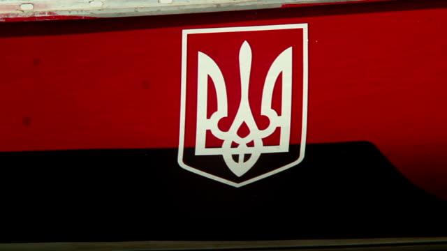 Ukrainian coat of arms onboard moored ship in harbor, emblem video