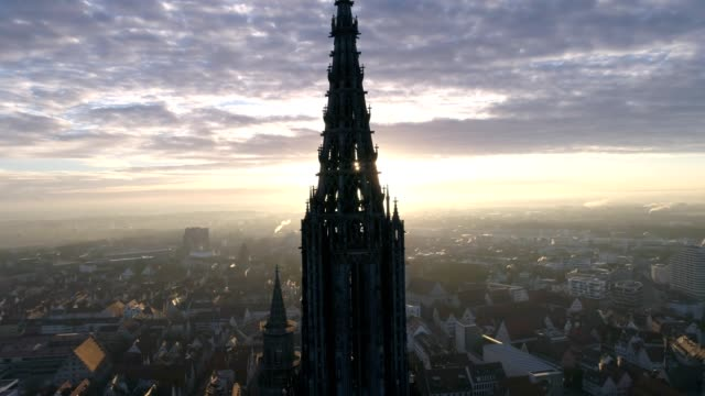 ulm minster sunrise with drone in slow motion - cathedrals stock videos & royalty-free footage