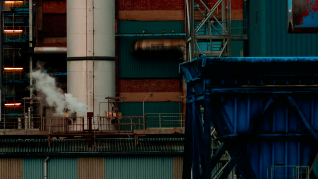 Ultra closeup shot of a plume of smoke coming out of a sugar factory chimney video