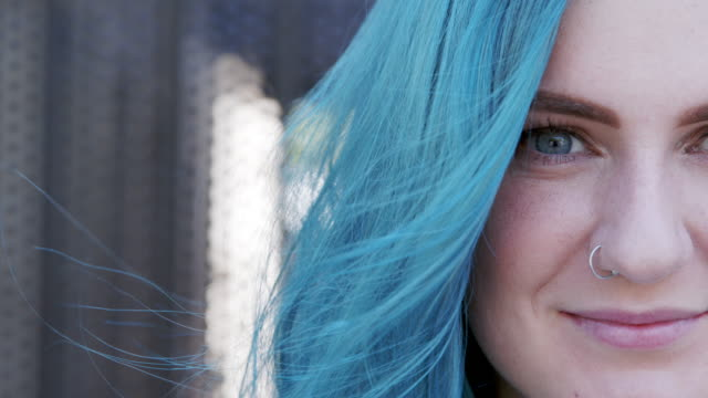 Ultra Close-Up Shot of Beautiful Unique Spunky Fashionable Young Woman with Fun Cute Teal Blue Green Dyed Hair Standing Posing Outdoors in the Summer Beautiful Unique Spunky Fashionable Young Woman with Fun Cute Teal Blue Green Dyed Hair Standing Posing Outdoors in the Summer blue hair stock videos & royalty-free footage