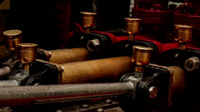 Ultra closeup view of three pistons of an outdoor hydraulic engine An ultra closeup view of three pistons of an outdoor hydraulic engine 19th century style stock videos & royalty-free footage