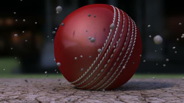 vídeos y material grabado en eventos de stock de ultra resolución bola de críquet impactante tierra con partículas - críquet