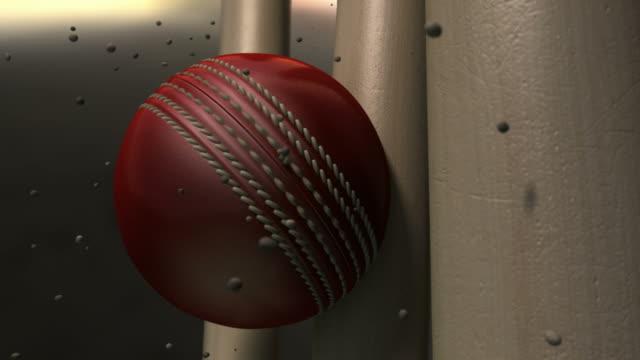 vídeos y material grabado en eventos de stock de ultra resolución bola de críquet impactante wickets con partículas - críquet