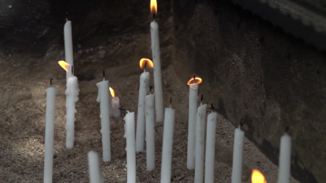 Ultra slow motion - Candles that burn for workship at church video